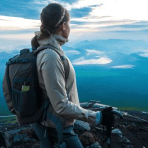 Woman climbing Mt fuji at Sunrise