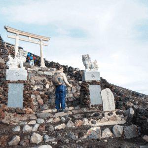 woman climbing Mt Fuji nearing the summit