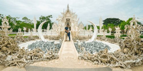 Couple kissing in front of the White Temple in Chiang Rai one of the Best Places in Thailand