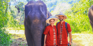 Couple at Elephant Sanctuary in Chiang Mai Thailand with Asian Elephant