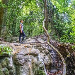 Walking through rainforest in Woman and Man hugging on Railay Beach West Thailand on Chase Your Adventure Tours