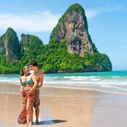 Woman and Man hugging on Railay Beach West Thailand on Chase Your Adventure Tours