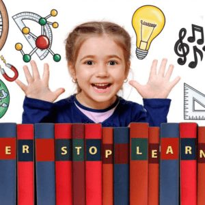 Little girl with books that say never stop learning