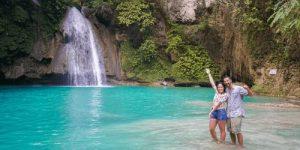 A couple at Kawasan Falls in Cebu Philippines