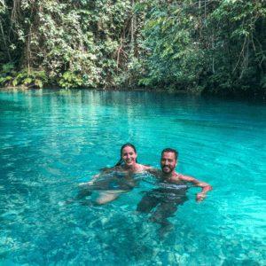 A couple swimming in Kawasan Falls in Cebu Philippines