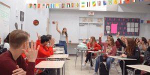 Digital Nomad Annette Fortner doing motivational speeches in a high school