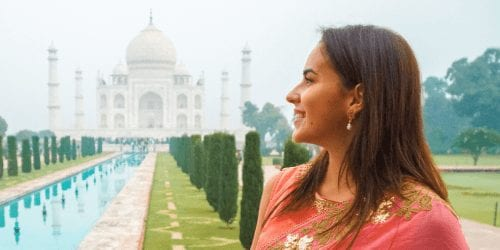 Girl in a saree staring at the taj mahal