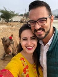 Woman and Man taking a selfie with a camel while Visiting Pushkar India