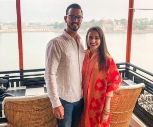 A couple standing in front of Pushkar Lake