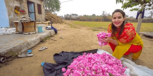 Woman in India holding a bunch of roses showing safety in India