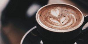 A cappuccino in a black mug