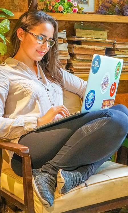 Girl sitting at her computer working remotely
