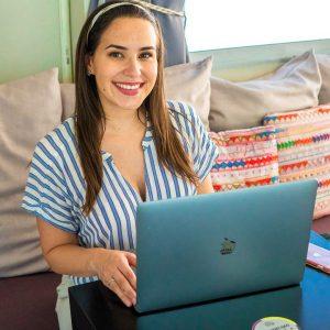 Annette Fortner working on her laptop as a digital nomad