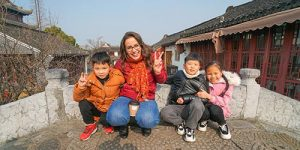A woman in China with Chinese kids around her